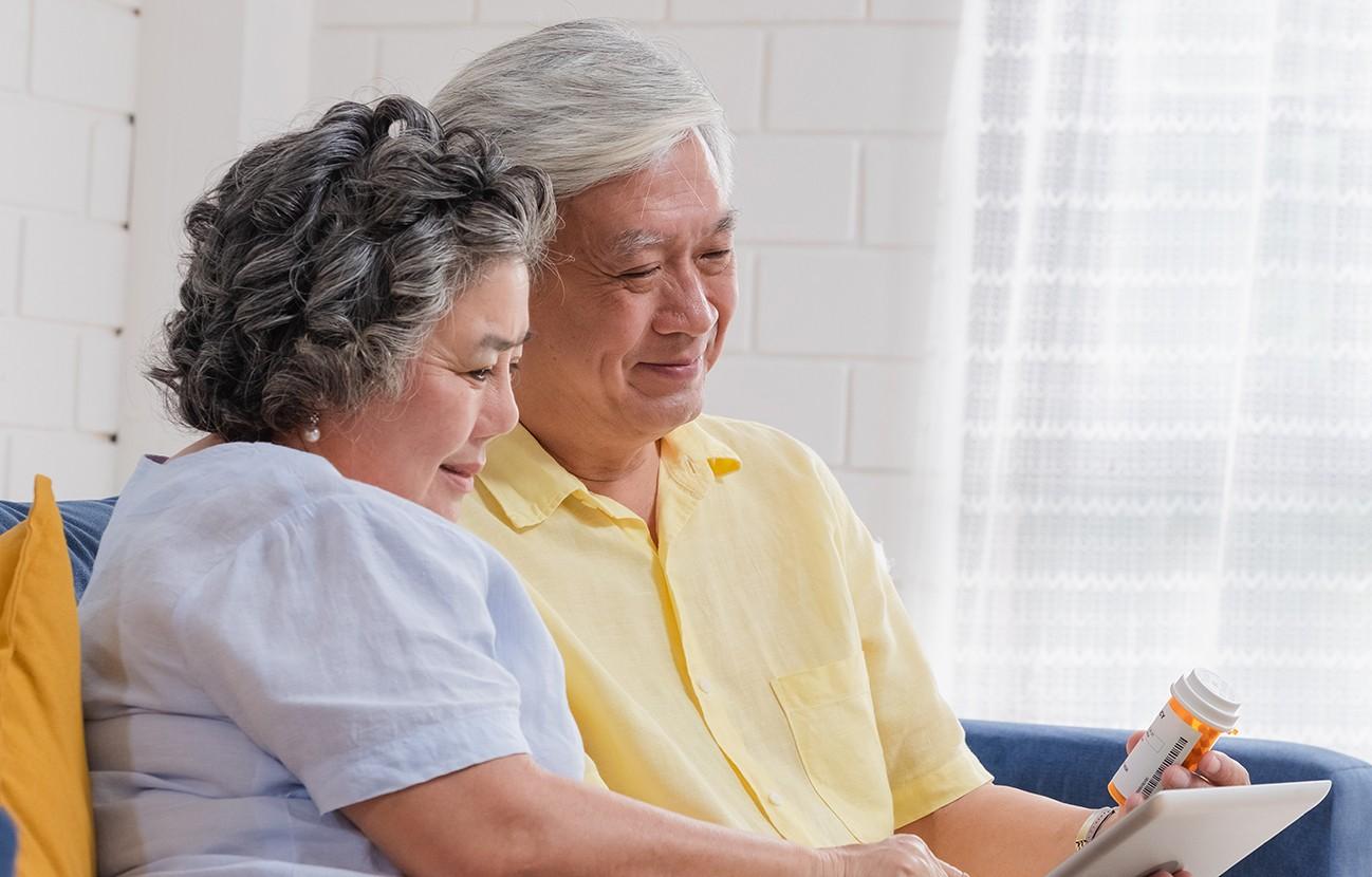 older couple reviewing prescription medication